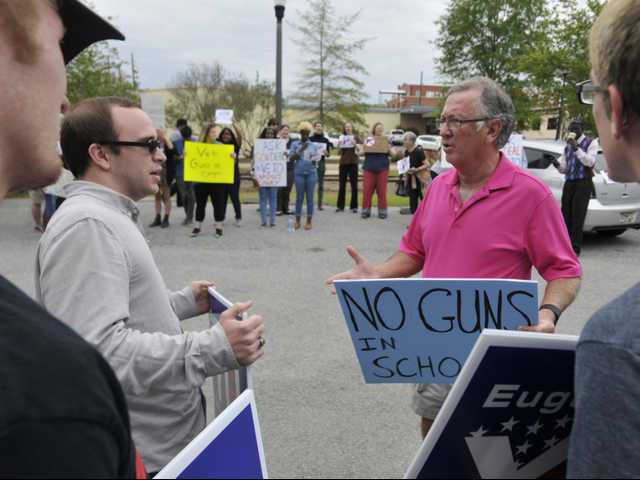 Protesters call for 'campus carry' veto