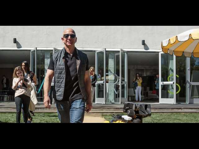 Amazon Ceo Jeff Bezos Posts Photo Taking His Robot Dog For A Walk