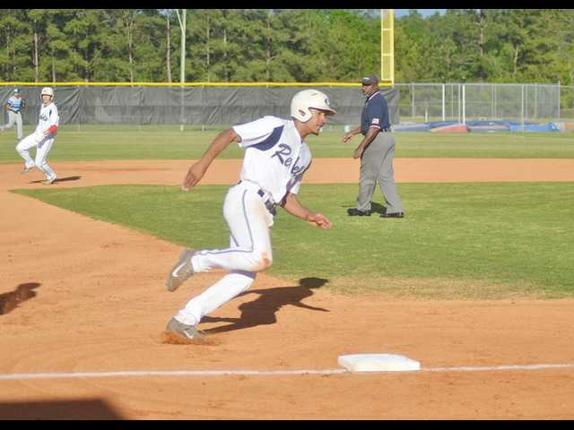 Balk lifts Rebels  in extra innings