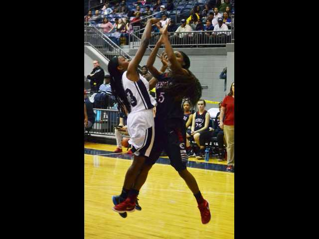 Lady Rebels rally past Lady Blue Devils