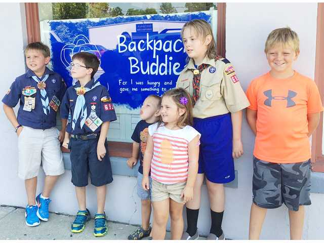 Cub Scouts pitch in for Backpack Buddies