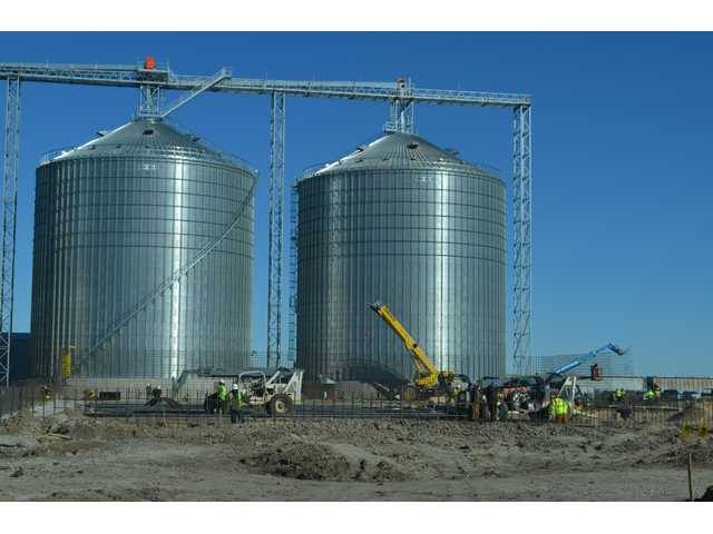 Employees from Macon General Contractors from Bradford, Ill. continue laying groundwork in 37-degree temperatures accompanied by brisk north winds for a 200-foot- by 400-foot grain storage facility for Bartlett Grain of Great Bend.