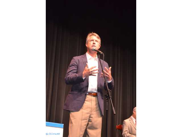 Senatorial candidate Dr. Roger Marshall, Great Bend, debated incumbent Sen. Tim Huelskamp, Hutchinson, Monday night in a much anticipated debate at which each candidate outlined their plans to change the state's tax policy.