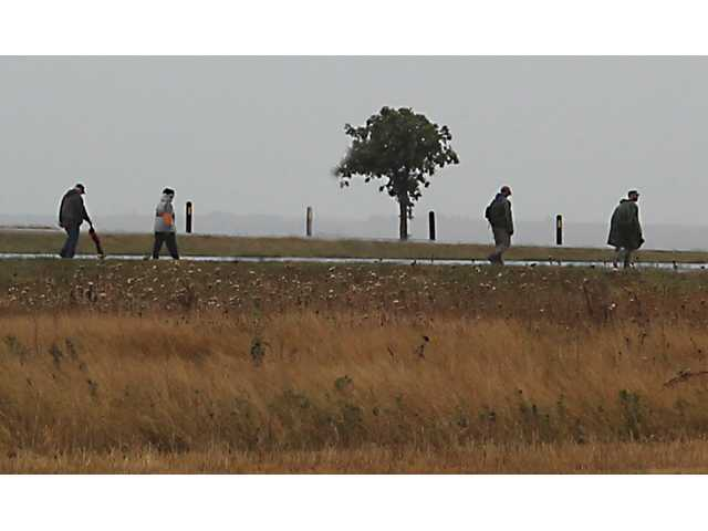 Marchers, though few in number, completed a 10-12 mile hike around Cheyenne Bottoms Saturday morning to raise awareness of the issues veterans in this area face each day in the struggle against PTSD.  Rain and cold weather weren't enough to keep them from meeting their challenge.