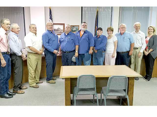 The Barton County Commission Monday recognized several Road and Bridge Department personnel for completing Kansas Roads Scholar Program level II training. Honored were Gary Demel, Mick Lang, Mike Moos and Stan Behrends (in dark shirts in the center). Also pictured are commissioners Don Davis, Homer Kruckenberg, Kenny Schremmer, Jennifer Schartz, Road and Bridge Director Dale Phillips, Kansas Association of Counties local road engineer Norm Bowers and Commissioner Alicia Straub. In all, the commission honored 11 Road and Bridge staff members for KRSP level I and level II completion.