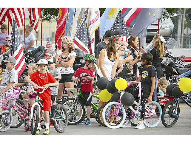 Entrants in the 2014 Hoisington Labor Day Parade line up for the annual event. This year's children's parade is set for 10 a.m. Monday and the regular parade for 10:30 a.m. This is just the culmination of a weekend full of Labor Day celebration activities in Hoisington.