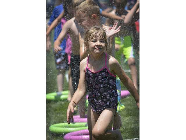 Wednesday water fun day at the Great Bend Public Library as children gathered on the library's front lawn in the afternoon for water balloon fights, a water-related obstacle course and cool treats. According to GBPL Children's Supervisor Dayna Ball, there were about 100 children ranging in age from 1-13 taking part. Some of the youngsters were from among the 280 attending the library's summer reading program. And, Ball said the library has teamed up with Great Bend USD 428, and some of those participating were summer school students. It was a beautiful day to get wet, she said.