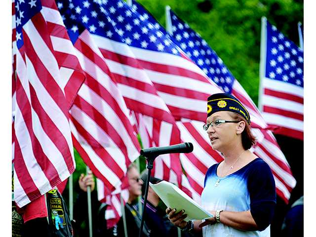Katherina Smades, American Legion Post 180 commander, gives her address during the 2015 Memorial Day service at Great Bend Municipal Cemetery Monday morning.