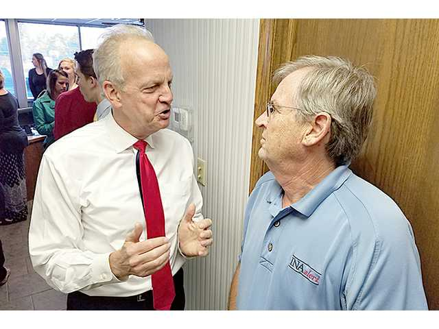 U.S. Senator Jerry Moran visits with Monty Strecker, his Barton County campaign chairman, following the Great Bend Chamber of Commerce coffee Thursday morning at Tele-Communications Inc. He was on his way to Hays for the dedication of a building in honor of Great Bend residents W.R. and Yvonne Robbins.