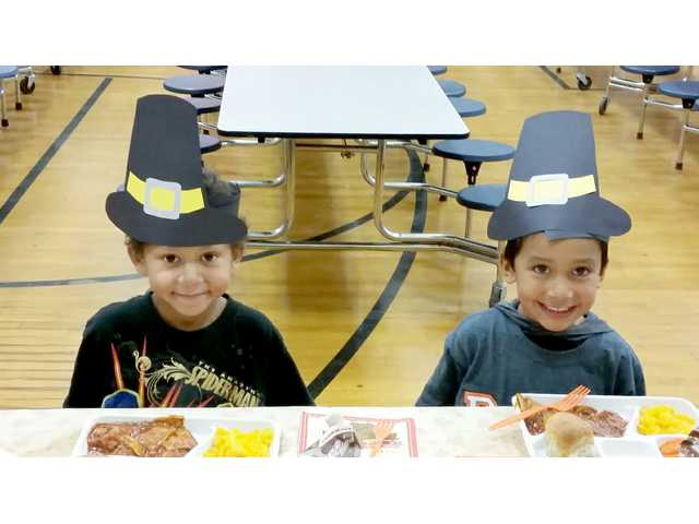 Dara Touslee's and Leah Yancey's Kindergarten classes celebrated Thanksgiving at Park School Tuesday. Students dressed as Pilgrims and Native Americans as they feasted on their lunch and ate pumpkin pie. Pictured are Romeo Green and Brian Mata, and the Thanksgiving table.