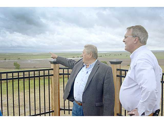 Barton County Commissioner Kenny Schremmer, left, points out Cheyenne Bottoms landmarks to Kansas Department of Wildlife, Parks and Tourism Secretary Robin Jennison Monday afternoon. The two had just attended the dedication of the new overlook tower at the wetlands located between Hoisington and Claflin on K-4.