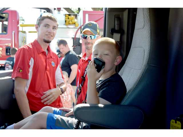 The Hoisington EMS hosted their fourth EMS Open House Thursday afternoon in celebration of EMS Week, part of a nationwide observance that builds awareness of the work emergency responders do everyday in pursuit of healthy outcomes for those involved in life-altering circumstances. EMS staff grilled hamburgers and hotdogs for a community barbecue, and police and firefighters were also on hand to meet the public. Children enjoyed climbing in and out of the ambulances and other first responder vehicles.