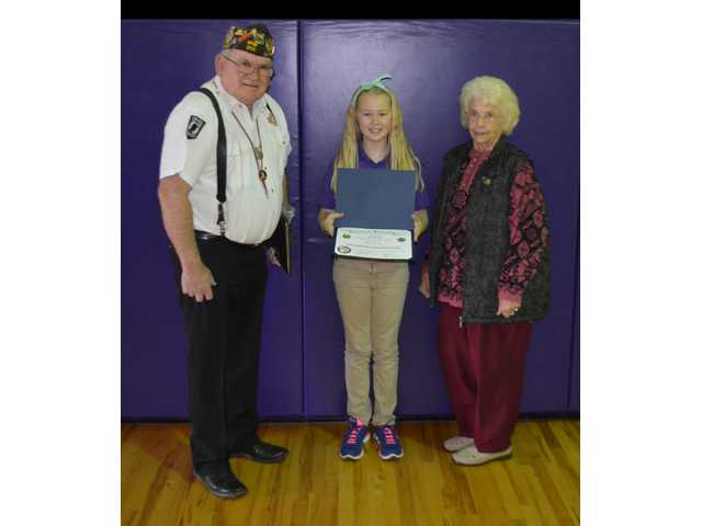 Tessa Fry is pictured here with LaForrest Bodine and Pearl White. Fry was the winner of the Patriot's Pen Award that is sponsored by VFW Post 3111 in Great Bend.