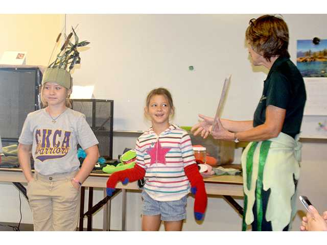 Educator Pam Martin of the Kansas Wetlands Education Center teachers second graders about the food chain that thrives in the Cheyenne Bottoms, Wednesday.