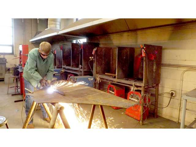 Jace Schwager works on a welding project in this recent photo taken in the Advanced Agriculture Mechanics class at Great Bend High School. Next year the class will be called Advanced Agricultural Welding.