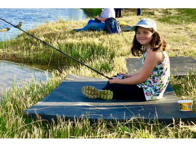 Peyton Marquez, 10, of Hutchinson, enjoys Camp Hope fishing Tuesday morning.