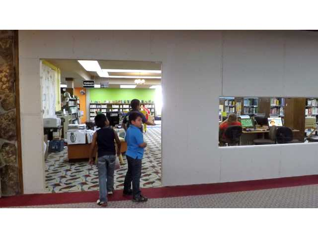The children's area at the Great Bend Public Library is getting a new look, with walls to separate it from other parts of the library. When it is finished, it will have double doors that can be closed during Story Time and other children's activities, to dampen the sounds heard in the rest of the library.