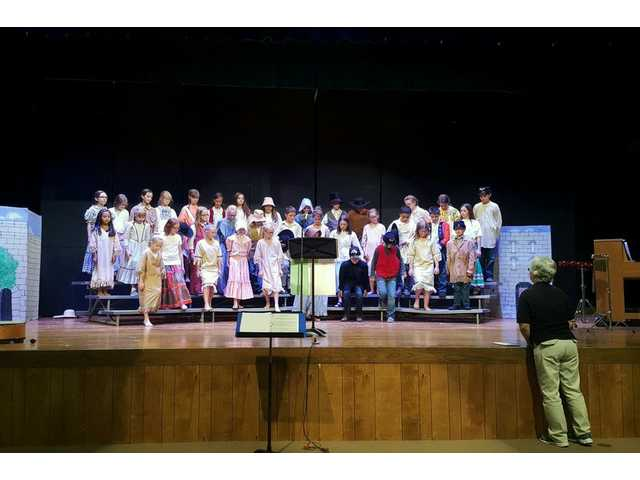 """Rendezvous 2016, a biennial gathering of Santa Fe Trail enthusiasts, included a noon performance of the St. George Elementary Honor Choir on Saturday afternoon.  The group, led by Janet Armstead, gave a musical interpretation of """"On the Trail to Santa Fe."""""""