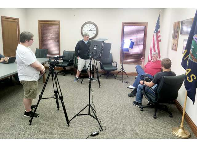 Students from Hoisington High School's video production, history and English classes collaborate on a community suggested project of oral history preservation. Harold Thorne, Hoisington, shares memories of Hoisington's past as prompted by interviewer Chris Ball. Video and audio production students Jakob Breit and Aaron Crawford work cameras and lighting, while Dylan Yott and A.J. Moshier (not pictured) transcribe the interview for a written narrative.