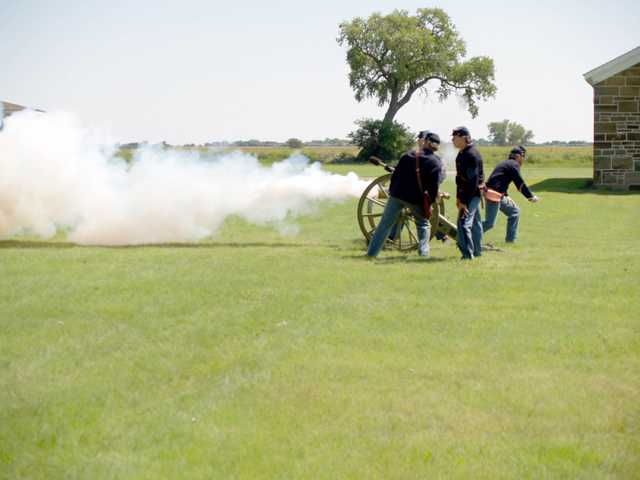 Re-enactors demonstrate the firing of artillery weapons at Fort Larned.  Demonstrations will be given this weekend as part of Fort Larned's Labor Day weekend living history programs.