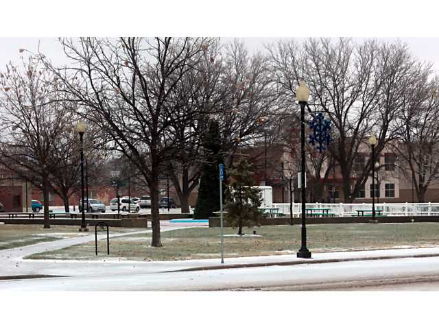 Road conditions near the Courthouse Square were passable, but the going was slow as of noon on Saturday.  Events marking the opening of the holiday season may be rescheduled when city offices open again Monday.