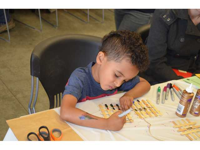 A youngster is carefull to perform his best artwork while dressing up a birdhouse at the Kansas Wetlands Education Center. Youngsters enjoyed an activity-filled day that started at the Kansas Wetlands Education Center and eventually moved to the Aldrich Center south of Claflin.