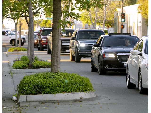 The city wants your input on how best to redo the 100 block of North Main Street when the bulbs outs are removed.