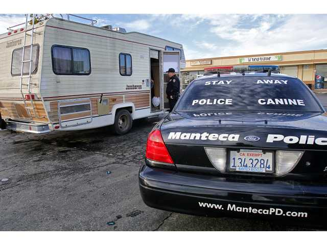 Manteca Police Community Resource Officer Mike Kelly orders an illegal camper in an RV to leave a shopping center parking lot.
