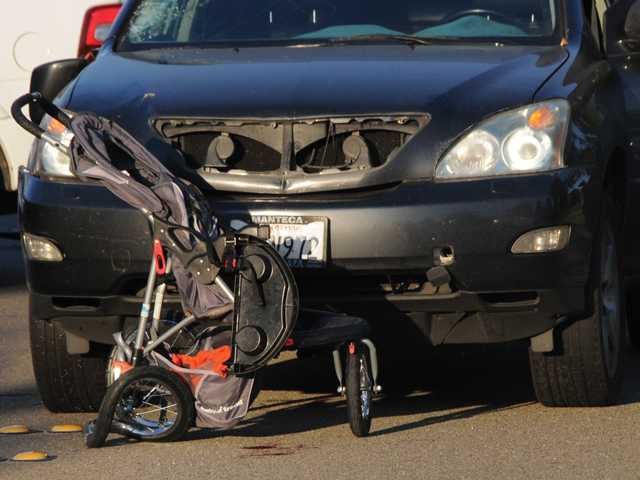A stroller came to rest  in front of this car during an accident that killed a man accompanying a toddler crossing Woodward Avenue.