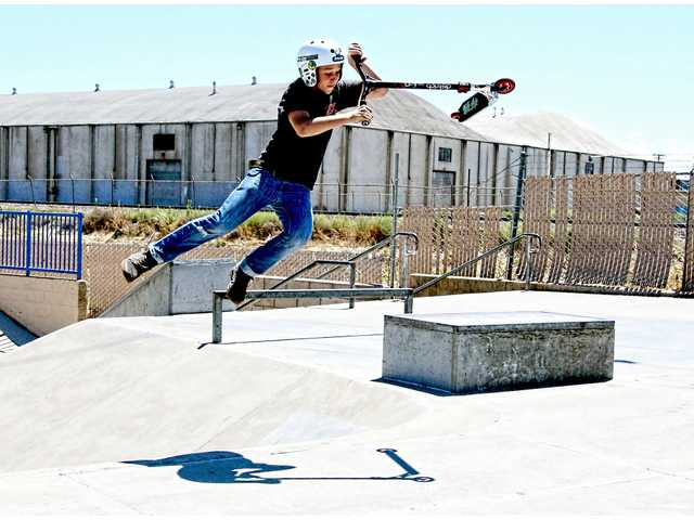 HITTING THE RAMPS AT THE SKATE PARK
