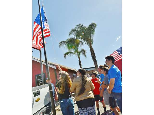 STUDENTS RAISE THE FLAG WITH RESPECT