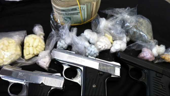 RCSO bust nets 300 pills, guns, cash