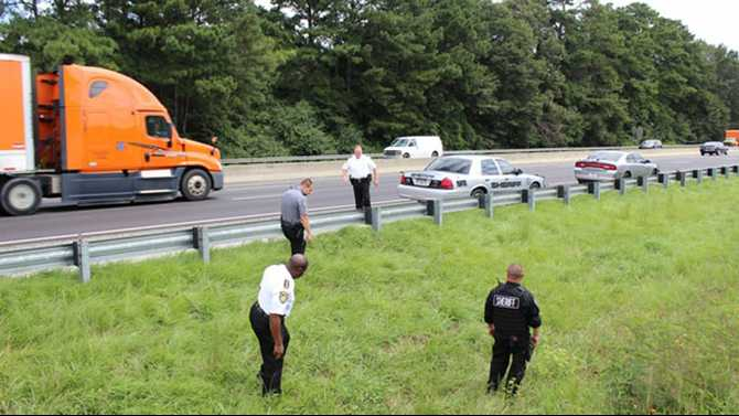Drugs, guns thrown out window during slow chase on I-20