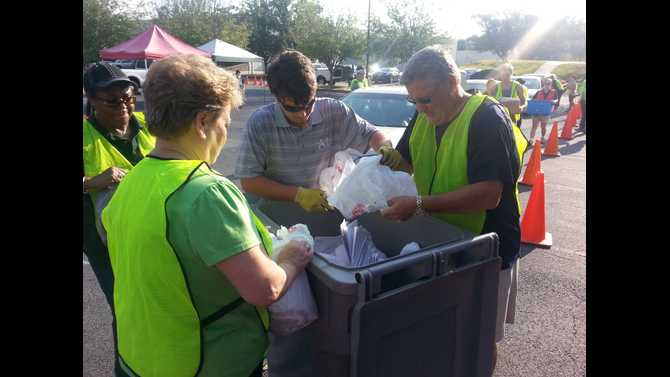 Dozens bring recyclables to the Electronics Recycling and Paper Shredding event