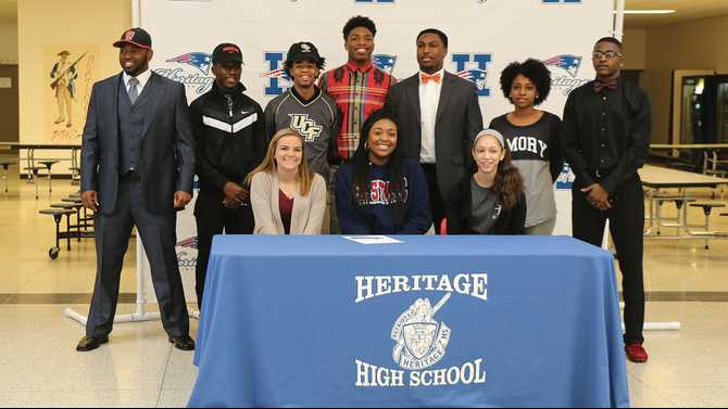10 HHS athletes sign on Signing Day