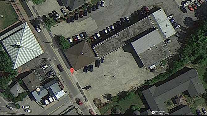 Eminent domain may be used for Olde Town parking lot