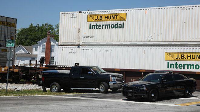 Train strikes truck