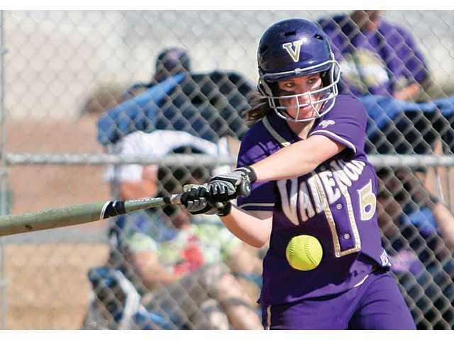 Valencia's Caitlin Rooney hits a home run against Hart during the fourth inning on Monday at Valencia High School. The Vikings limited Hart's offense in a 3-0 victory.