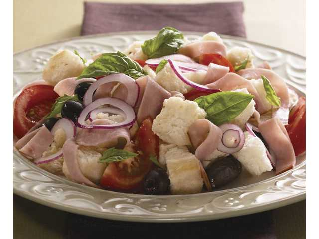 Panzanella SaladServing Size: 4 8 slices Italian or rustic bread, 4 to 5 days old, crusts removed 3 medium tomatoes, coarsely diced 12 Kalamata pitted olives, quartered 1 medium red onion, minced 1/3 cup vinaigrette 12 large fresh basil leaves, shredded 1 (8-ounce) package Hormel Natural Choice smoked deli ham, cut into strips Tear bread into pieces; soak in bowl of cold water 2 to 3 minutes. Drain; squeeze bread dry, removing all water. In large bowl, tear bread into smaller pieces with fork. In small bowl, combine tomatoes, olives, onion and vinaigrette; stir gently. Add vinaigrette mixture to bread pieces; mix well. And basil and ham; mix gently to combine.