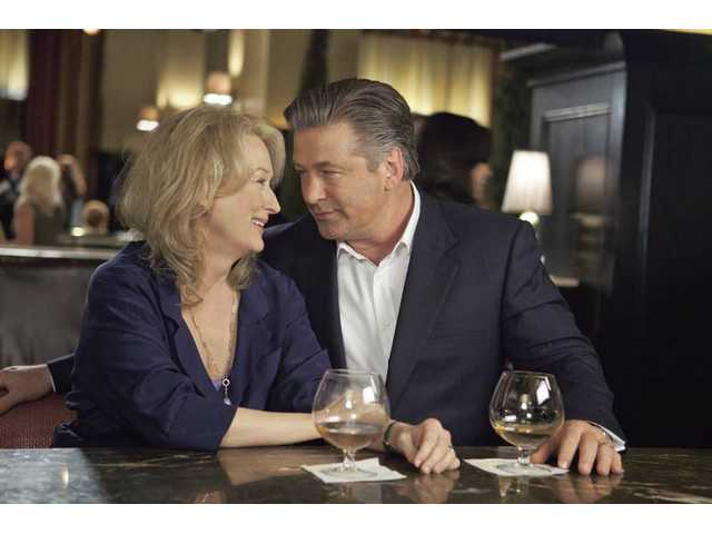 "Meryl Streep, left, and Alec Baldwin are shown in a scene from ""It's Complicated."" You'll like everyone in this movie, which makes use of writer/director Nancy Meyers' tried and true ploys."
