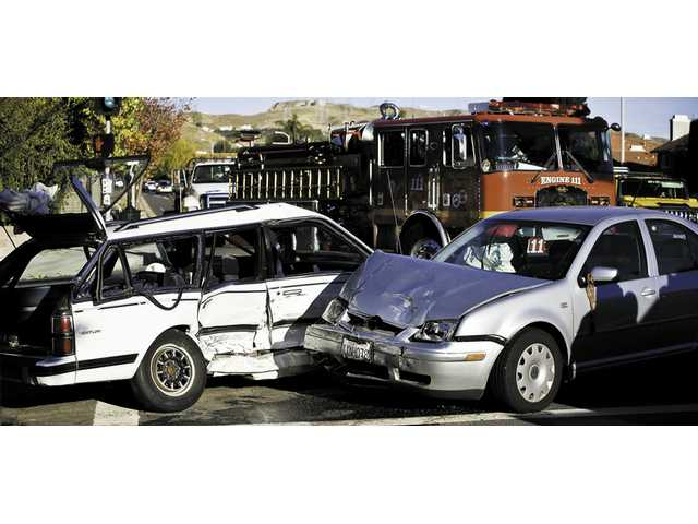 Vehicles shattered after a high-impact crash at Bouquet Canyon Road and Wellston Drive Wednesday.