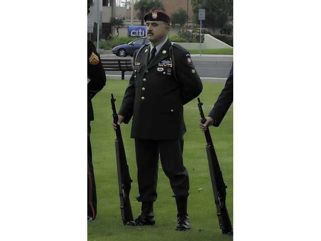 Davison performs at a December 7th ceremony in Ventura as part of the First Memorial Honor Guard. He is wearing his Vietnam Class-A dress uniform signifying his rank as a Specialist E4. When he serves with the National Guard or with the State Military Reserve, he is a sergeant.