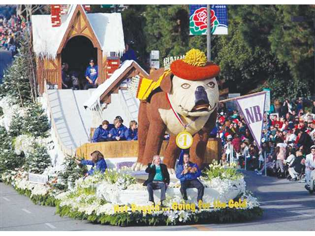 The Natural Balance pet food float carrying local wonderdog Tank, who snowboarded down the float's hill, cruises down Colorado Blvd. in Pasadena during the Rose Parade on Friday.