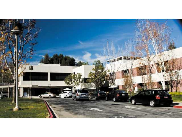 The main entrance of Henry Mayo Newhall Memorial Hospital at the intersection of Orchard Village Road and McBean Parkway in Valencia.