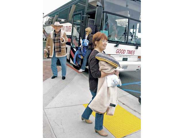 Jay Cappillia, left, and Jullia Vose, right, of Saugus, exit the bus after returning home.