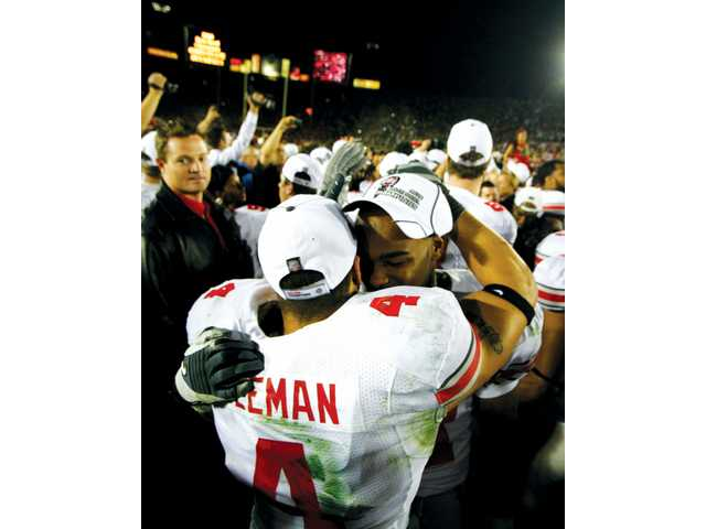 Ohio State defensive back Kurt Coleman (4) hugs teammate Anderson Russell (21) after their team's victory. The win snapped Ohio State's three-game Bowl Championship Series losing streak.