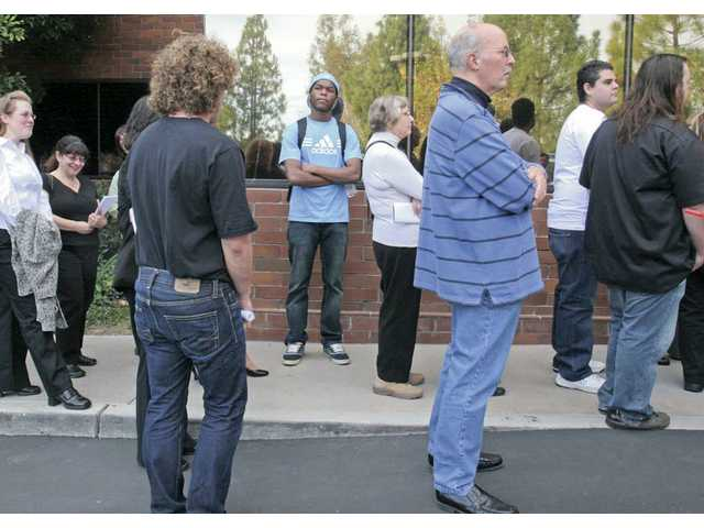 Eighteen-year-old College of the Canyons student Emrin Bodian, center facing camera, waits to enter Santa Clarita's new Census Bureau office on Wednesday. Bodian, who moved to the Santa Clarita Valley from the Ivory Coast two years ago, wants to get a job at the local office.