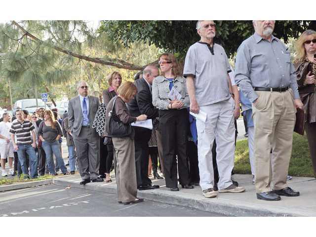 Job seekers line up Wednesday outside Santa Clarita's new Census Bureau office in hoping to land one of the estimated 1,500 part-time and full-time positions.