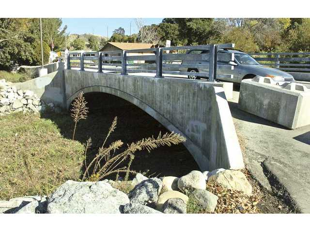 This Dec. 16, 2009, photo shows the bridge leading to the Polynesian Mobile Home Park in Canyon Country. A rent increase on residents of the park is proposed to offset the cost of flood damage repairs, including this bridge at the park entrance.