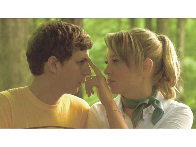"Michael Cera, left, and Portia Doubleday are shown in a scene from, ""Youth in Revolt."" Cera gets to play two characters in the movie, which opens this week."